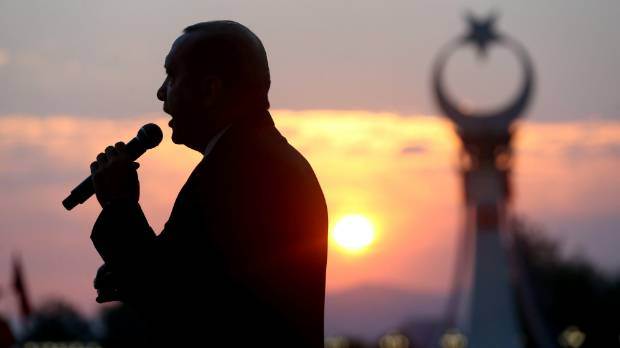 Turkish President Tayyip Erdogan addresses his supporters during a ceremony marking the first anniversary of the ...