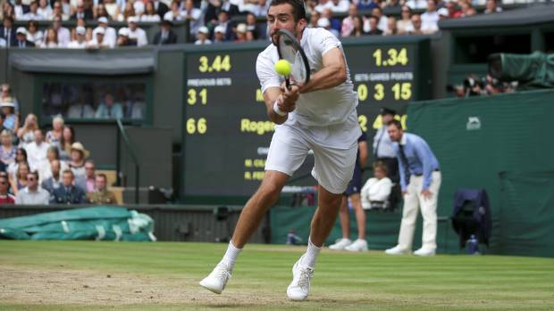 Marin Cilic in action during the final against Roger Federer