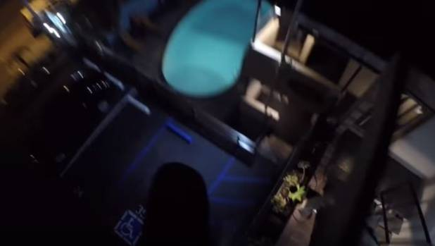 A still from 8Booth's video shows the moment he jumped from the hotel roof.