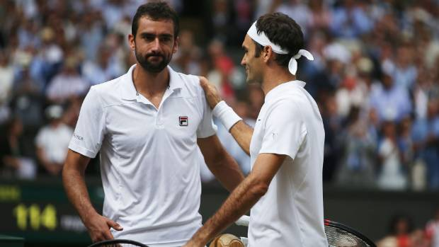 Roger Federer and Marin Cilic shake hands after the men's final.