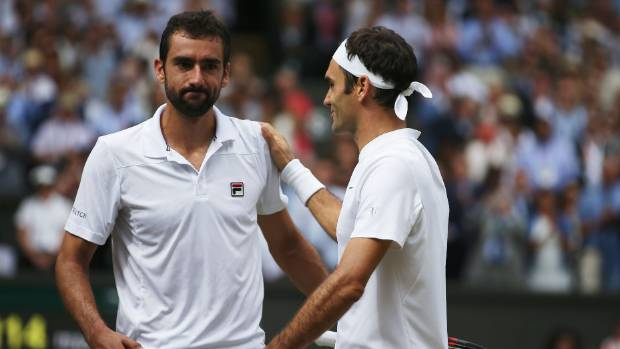 Roger Federer, right, consoles Marin Cilic after winning his eighth Wimbledon men's singles title.