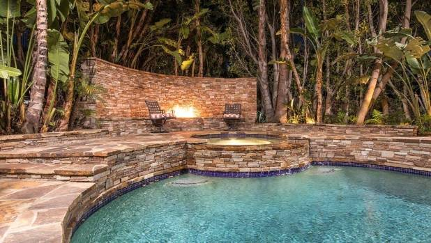 The property's outdoor entertaining facilities include a poolside fire pit.