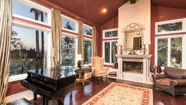 The expansive family room features Venetian plaster walls and cherry wood flooring.