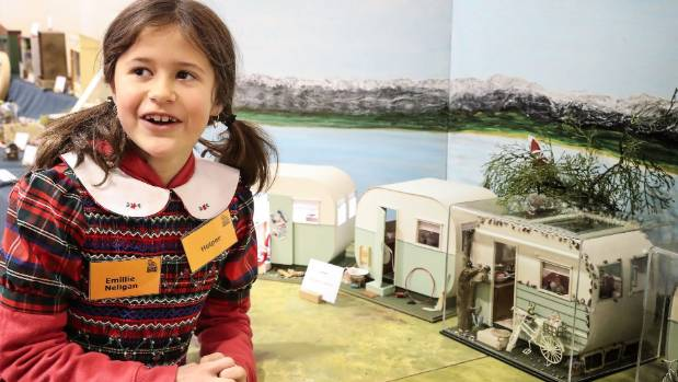 Emillie Friend with the miniature caravans on display.