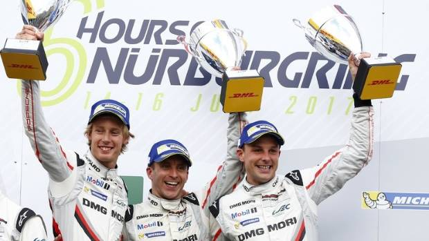 The Porsche team of Brendon Hartley (New Zealand), left, Timo Bernhard (Germany) and Earl Bamber (New Zealand) won the ...