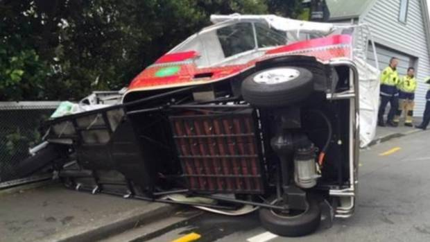 The toppled tuk-tuk at the crash scene, in Roseneath Tce, Wellington.