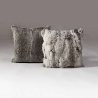 Offset the harshness of an antler table with a warm rabbit fur cushion on a  nearby sofa. Rabbit Cushion in white and ...