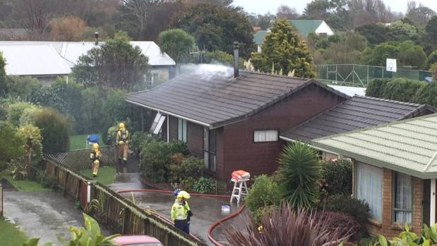 Firefighters at the Kapiti Coast house.