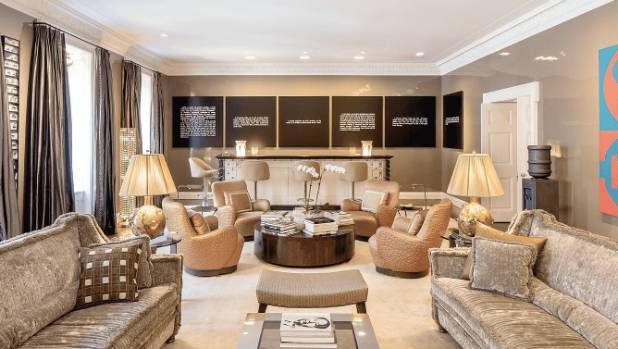 The formal living room is over 12 metres long, with four over-sized windows looking out to Park Avenue and a bespoke ...