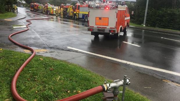 Fire services hook up to a water supply as they fight the Rimu Rd blaze.