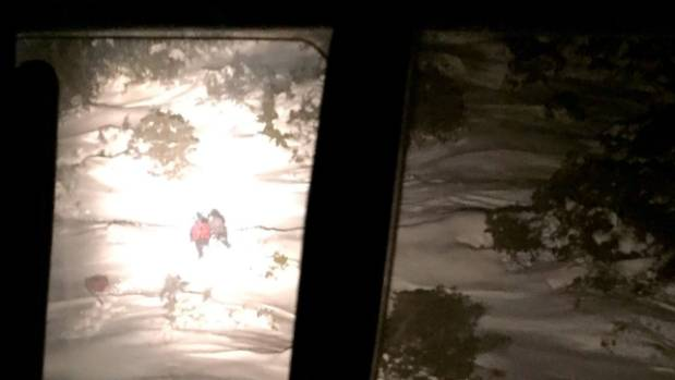 The woman was discovered in deep snow drifts, huddled on the edge of a tree line at about 4800 feet elevation and well ...