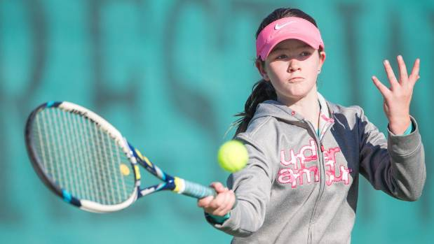 Marlborough player Stella Henry plays a forehand return during her match on Saturday at the Marlborough Junior Winter Open.
