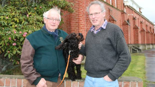Robert Hayes, with his dog Fergus, and Mike Connell are fighting to get transmission lines for a proposed wind farm put ...