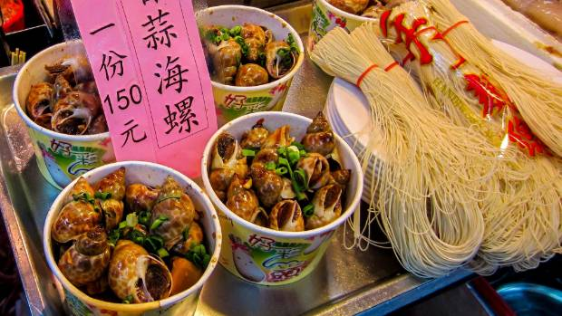 Snails and noodles for sale at Shilin Night Market.