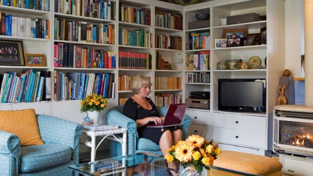 Felicity Price in her family room filled with books and treasures. Twenty-eight years of accumulating stuff is a habit ...