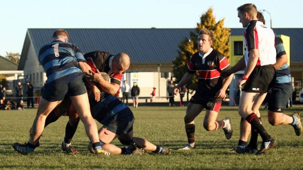 North Canterbury captain Stew Dalzell is tackled.