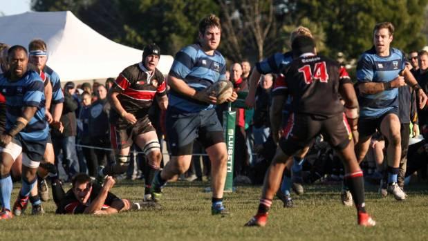 Ellesmere's Matt Stone carries the ball froward.
