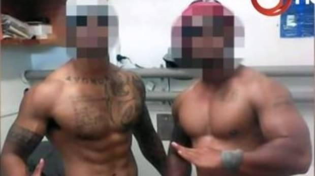 Inmates posing in a photo posted to a Facebook page.