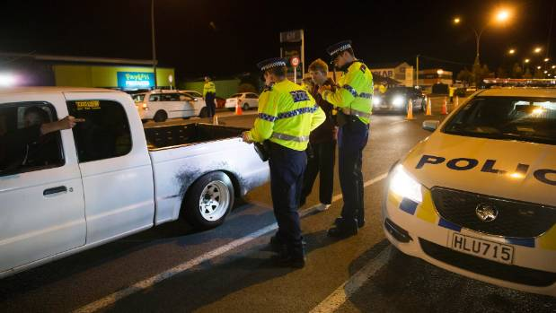 Waikato road police staff run a checkpoint on Te Rapa Straight, stopping vehicles on Friday night.