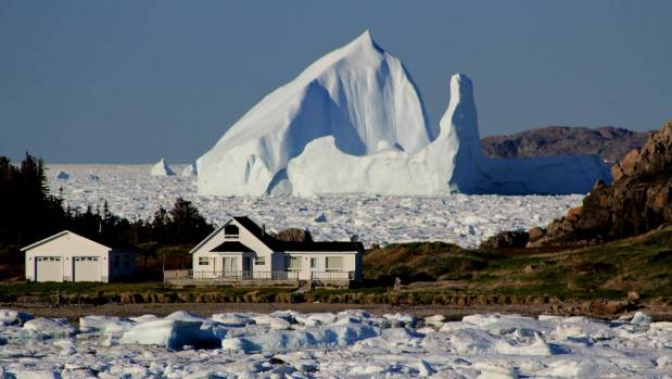 A giant iceberg passes Little Harbour in Twillingate, Newfoundland and Labrador.