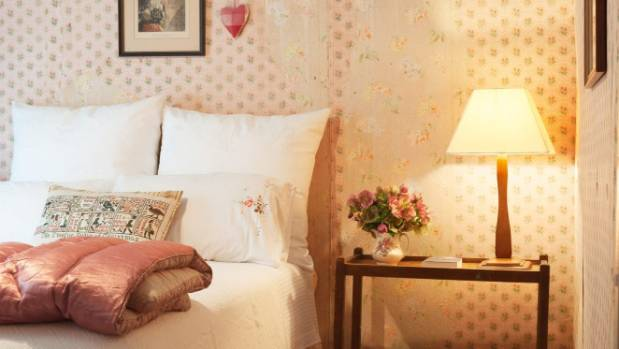 Ellen Hopkins' conserved 1950s bedroom, where five layers of early wallpapers were found.