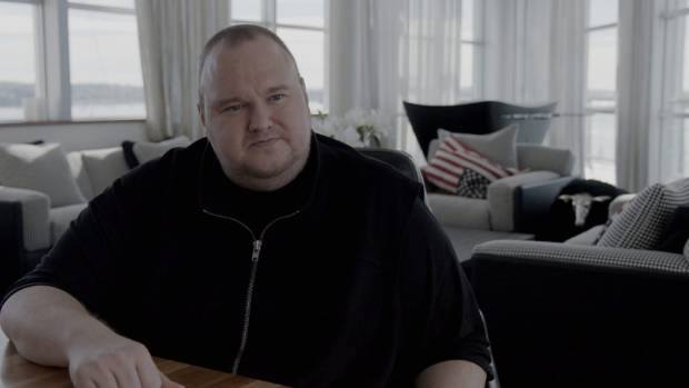 Kim Dotcom and his possibly meaningful US flag cushion in the documentary Kim Dotcom: Caught in the Web.