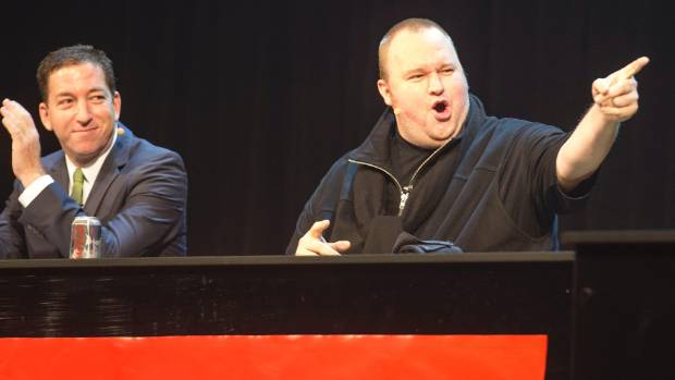 Glenn Greenwald, left, and Kim Dotcom at the Moment of Truth event that threatened to derail the 2014 election.