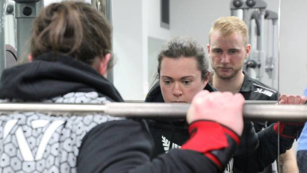 Graveston and trainer, Zach Trusler, who says women aren't at risk of 'bulking up' by lifting heavy weights