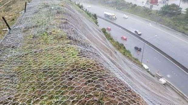 Overhanging rock has been removed and netting put in place after a slip on Wellington's Ngauranga Gorge restricted lanes ...