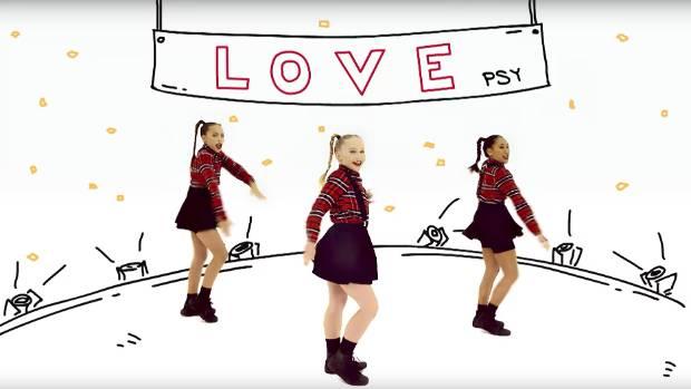 Former Taranaki girl Briannah Whakatau, far right, has danced her way into K-Pop phenomenon Psy's latest music video.
