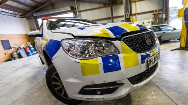 Three police patrol cars were rammed by a teenage driver attempting to flee in a stolen car on Sunday.