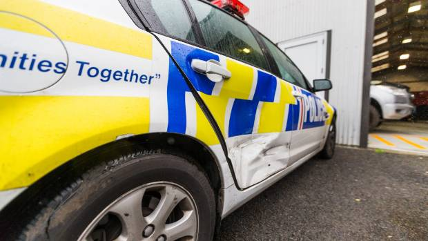 A police patrol car bears the scars after being rammed by a teenage driver in a stolen car near New Plymouth on Sunday.