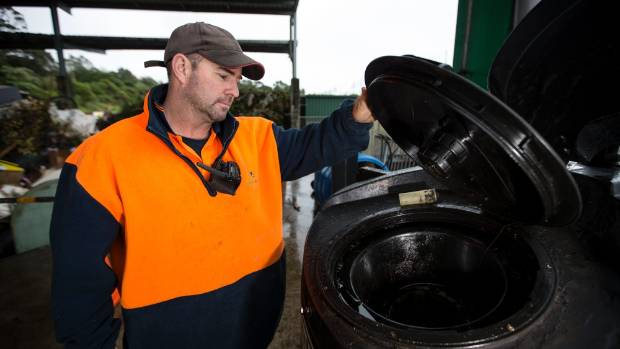 nviroWaste Colson Rd Refuse Transfer Station site manager Nigel Montgomery checks oil has been disposed correctly.