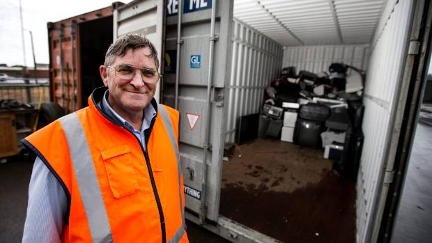 NPDC Senior engineering officer,  Mike Baker inspects a container that will be filled with e-waste and sent to Auckland.