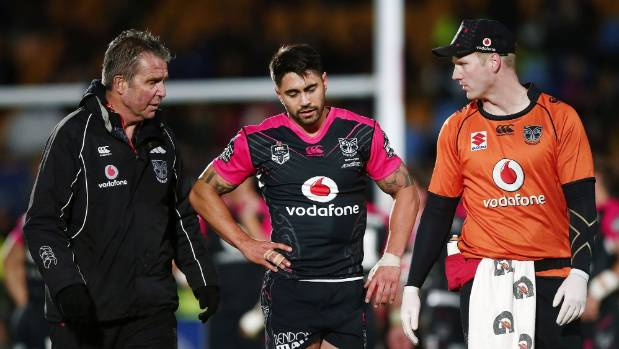 Shaun Johnson leaves the field with Warriors doctor John Mayhew, left, with what was initially thought to be a ...