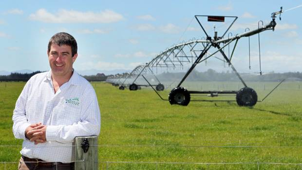 Andrew Curtis of Irrigation NZ in front of a centre pivot irrigation system at Burnham.