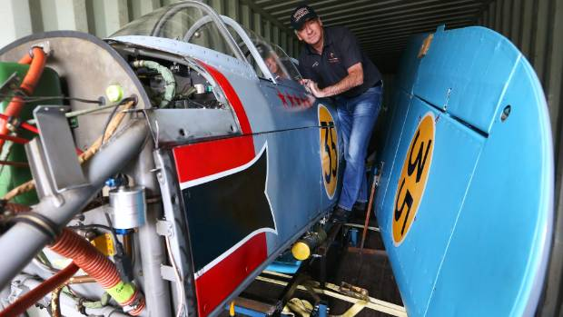 Graeme Frew inspects the Yak-3 before it ships out to Los Angeles. The number 35 on the wing and the fuselage, down to ...