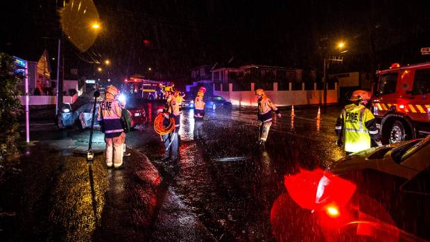 Police and fire crews attend a crash in New Plymouth on Monday