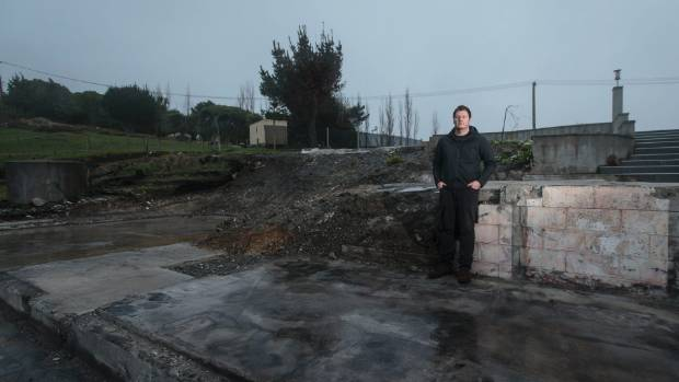 Kieran Grace, standing in the remnants of his Worsleys Rd home which was destroyed in February's fires, is one of ...