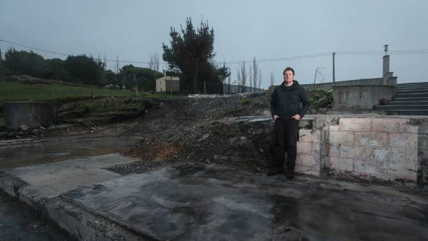 Kieran Grace, standing in the remnants of his Worsleys Rd home after it was destroyed in February's fires, is one of ...