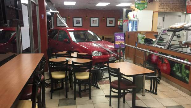 A red Volkswagen crashed through the doors of the East Tamaki Subway restaurant on Monday night.