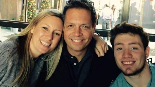 Justine Damond, left, pictured with her fiance Don and Don's son Zach.