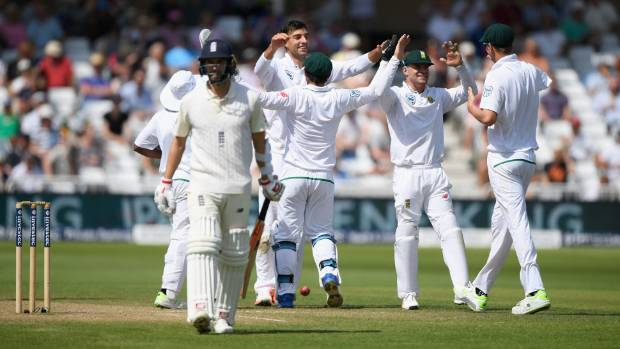 Proteas players celebrate after Duanne Olivier dismissed England's Mark Wood during the fourth day of the second test.