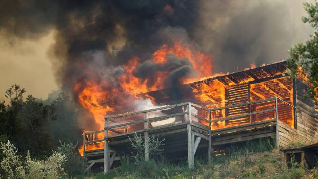 A cabin burns during a forest fire at Lustica peninsula near Tivat, Montenegro.