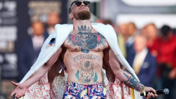 Conor McGregor poses on stage during the Floyd Mayweather Jr v Conor McGregor world press tour event at Barclays Center ...