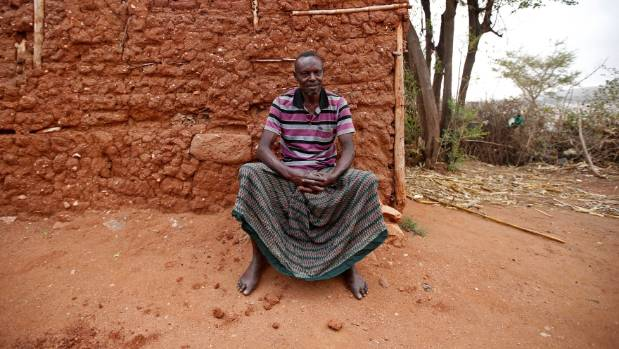 Yusuf Mume salleh, 70, known as the first Hyena Man, sits near his house.