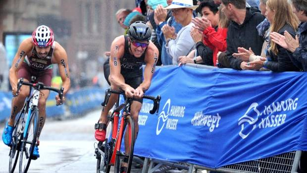 Ryan Sissons, right, competes in the mixed relay world triathlon champs in Hamburg.