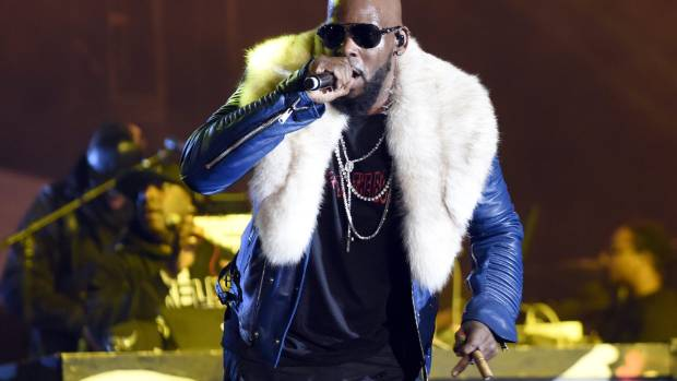 R Kelly, seen here performing in California, has been accused of 'brainwashing' women.