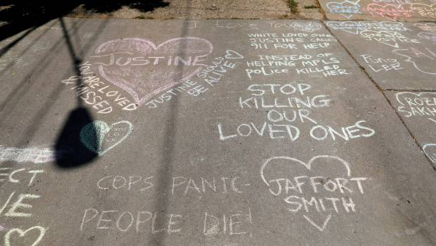 Memorials on the alleyway for Justine Damond who was shot by a Minneapolis police officer.