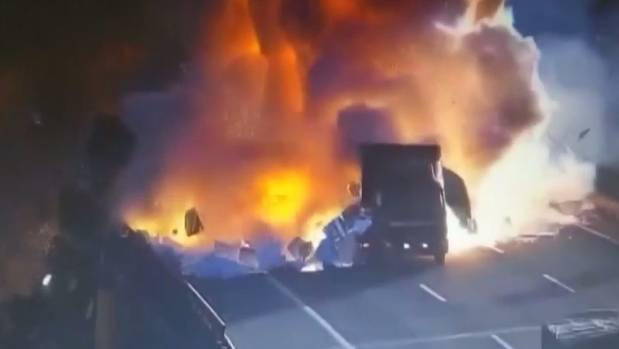 A truck explodes after clipping another vehicle on a highway in China.